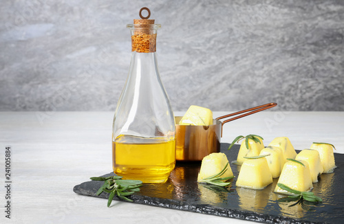Composition with rosemary and olive oil ice cubes on table