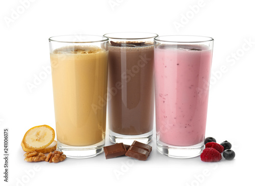 Glasses with different protein shakes and ingredients isolated on white