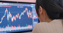 Woman Study The Stock Market D...