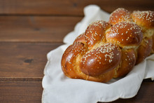 Traditional Jewish Sweet Challah Bread On A Wood Plate On Wooden Table / Background With Copy Space