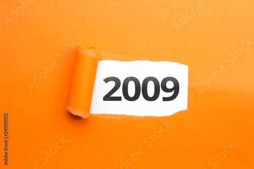 Fotografia  surprising Number / Year 2009 orange background
