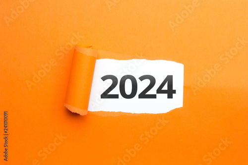 Fotografia  surprising Number / Year 2024 orange background