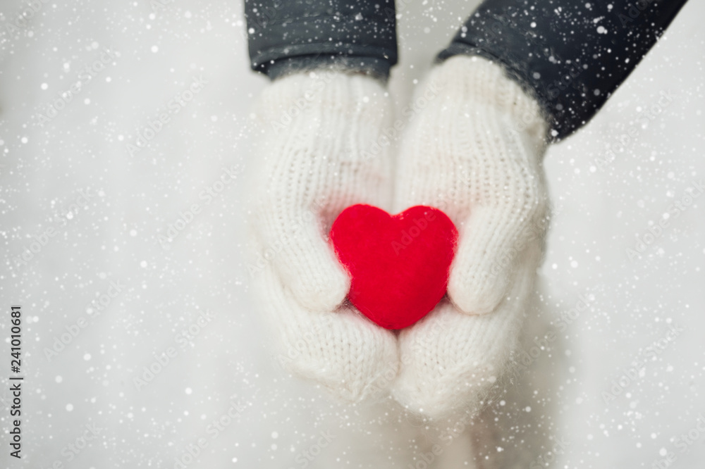 Fototapety, obrazy: Red heart in woman's hands wearing white woolen mittens. Valentine's Day concept