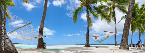 Fotografía  COPY SPACE: Young female tourist relaxing on the sandy beach by the ocean