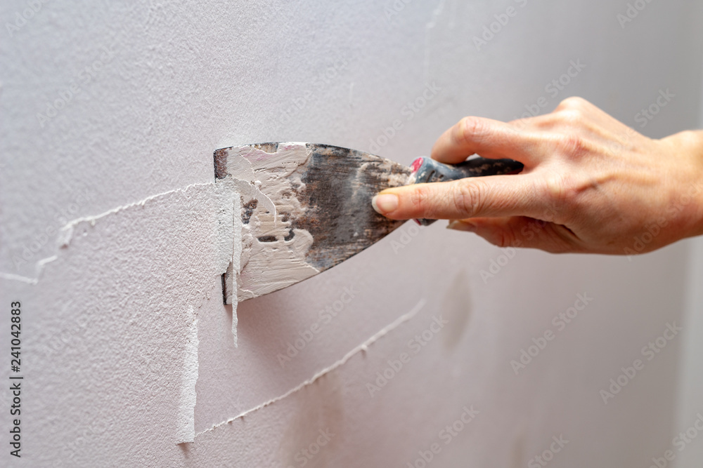 Fototapety, obrazy: Stripping old paint from the wall. Renovation and painting of walls in the apartment.