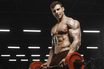 Fototapeta na wymiar Handsome strong athletic men pumping up muscles workout barbell curl bodybuilding concept background