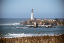 Pigeon Point Lighthouse, Landscape View With Brush And Ocean Waves In The Foreground, On A Clear Sunny Day On The California Coast