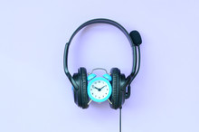 Concept Of Time To Listening Music. Alarm Clock And Headphones