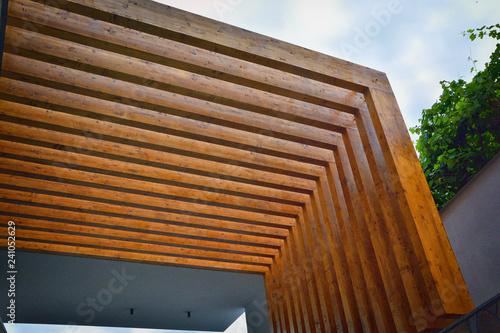 detail of wooden pergola with blue sky in background Fototapeta