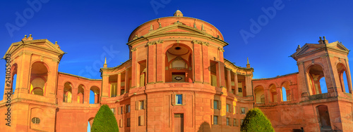 Poster de jardin Con. Antique Wide angle panorama San Luca Holy Mary Sanctuary of Bologna at sunset. The Catholic cathedral of San Luca is located on the hills of Bologna city. Sunny with blue sky. Banner cityscape.