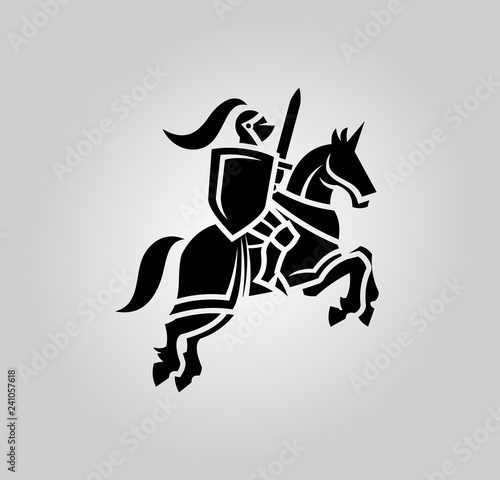 Vászonkép Knight with sword and shield on a horse
