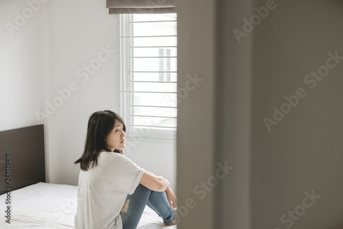 Fényképezés Asian woman depressed have a headache and feeling sorrow in bedroom