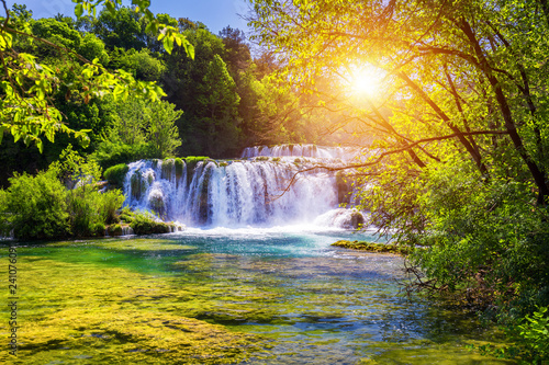 Photo Stands Waterfalls Beautiful Skradinski Buk Waterfall In Krka National Park, Dalmatia, Croatia, Europe. The magical waterfalls of Krka National Park, Split. An incredible place to visit near Split, Croatia.