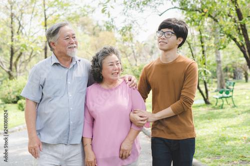 Fotografie, Tablou Happy asian family. Grandson take care grandma in the park.