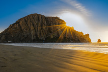 Sunset On The Beach, Rock, And Colorful Bright Sky With Sunbeams, Morro Bay, California