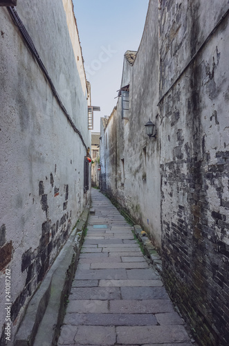 Fotografie, Obraz  Narrow alleyway between old walls in the old town of Xitang, China