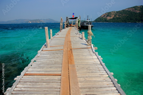 Koh kham small island and wood bridge on the beach with blue sky and clear water. Koh kham pattaya thailand.