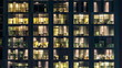window of the multi-storey building of glass and steel lighting and people within timelapse