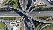 Aerial Photo Of Multilevel Elevated Highway Junction Highway Passing Through Modern City In Multiple Directions