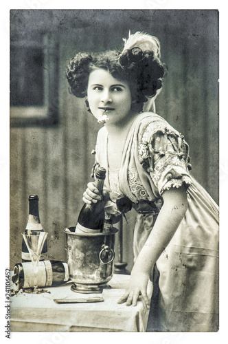 Fotografie, Obraz  Young woman bottle champagne wine vintage dressed Retro picture