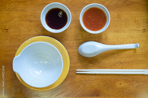 Flat lay of stylish dining set arrangement for shabu shabu