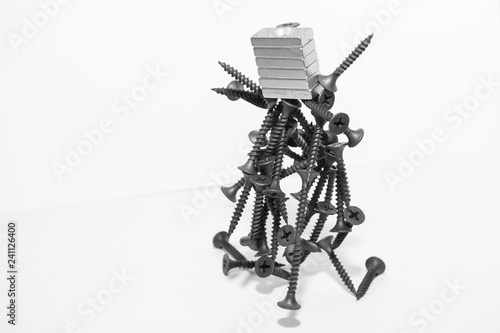 Foto op Plexiglas Art Studio Abstract figurine of black self-tapping screws hanging on the magnet