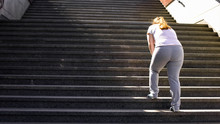 Hard To Climb Stairs For Obese Girl, Victory Over Fatigue For Goal Achieving