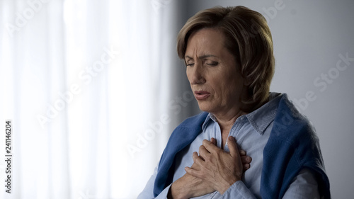 Fotografie, Tablou  Elderly lady having asthma attack symptoms, hard to breath and pain in chest
