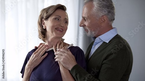 Senior couple celebrating anniversary, lady happy with necklace jewelry delivery Tapéta, Fotótapéta