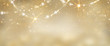 canvas print picture Christmas golden glowing background. Holiday abstract glitter defocused backdrop with blinking tars and garlands. Blurred gold bokeh