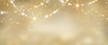 Christmas Golden Glowing Background. Holiday Abstract Glitter Defocused Backdrop With Blinking Tars And Garlands. Blurred Gold Bokeh