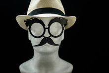 Styrofoam Head With A Straw Male Summer Hat And Glasses With Moustache On Black Background Closeup