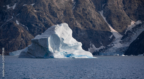 Foto op Plexiglas Arctica blue striped iceberg among the fjords of Greenland