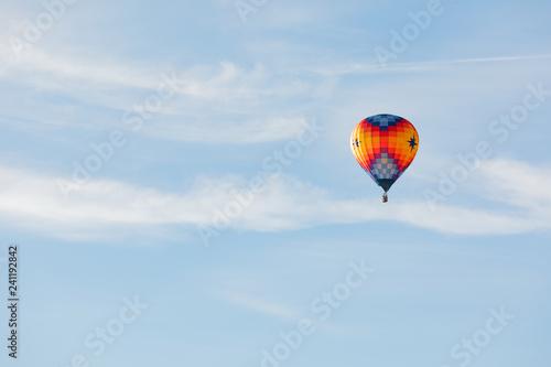 Hot air balloon flying over blue sky