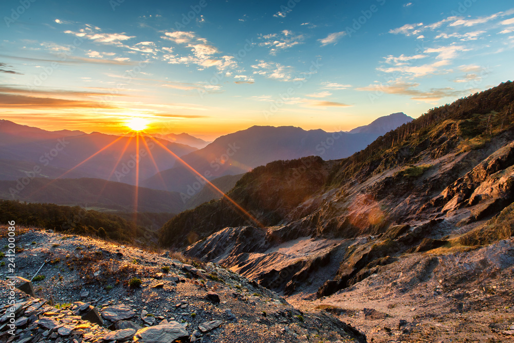 Fototapety, obrazy: Hehuanshan, Taiwan, is a popular destination for the local people. One can enjoy magnificent sunrise, mountain ranges, alpine landscape, and steep valley. The sun provides warmth to the place.