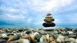 Stacked pebbles along the beach. This image is suitable for background use. It provides a feel of peacefulness, harmony, quietness and relaxation.