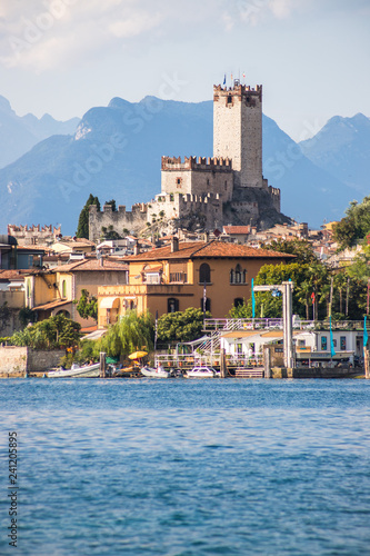 Idyllic coast in Italy: Blue water and a cute village at lago di garda, Malcesine
