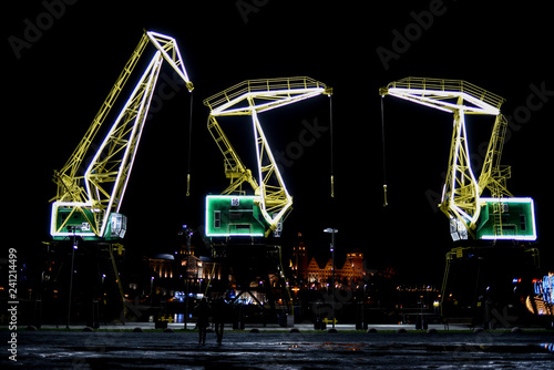 Foto auf Gartenposter Kunstdenkmal Highlighted cranes in Szczecin, a city monument. Highlighted cranes in Szczecin, a city monument.