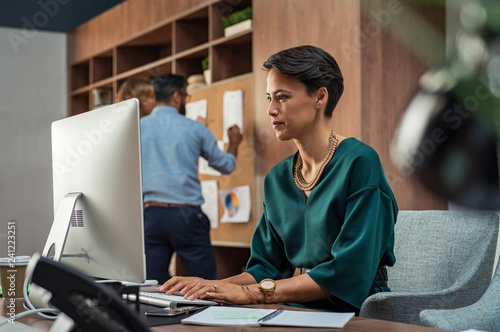 Young creative woman working on computer