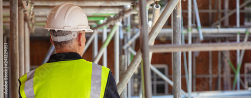 Rear View of a Construction Worker on Building Site Canvas Print
