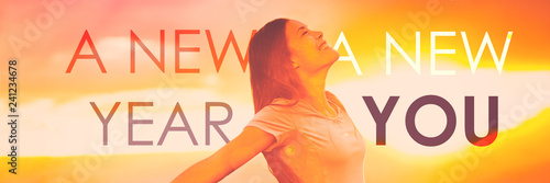 New Year New You happiness healthy happy woman with open arms in freedom and carefree banner panorama. Girl wellness concept on sunset background.