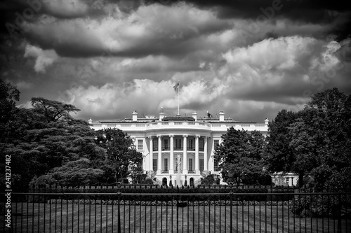 Fotografie, Obraz Dark and foreboding monochrome view of the White House with storm clouds brewing