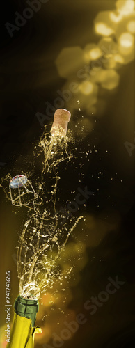 Champagne cork fly, sparkling wine splashes, New Year's Eve
