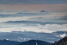 Frozen Winter Landscape With Blue Mountain Ridges, Forests, Hazy Valleys And Distant Conical Peak Under Pink Clouds, Orava Liptov Regions Oravska Magura Chocske Vrchy Ranges Slovakia Eastern Europe