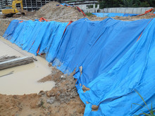 Temporary Slope Protection Using Huge Plastic Sheet At The Construction Site. It Is To Keep The Soil Profile And Avoid Soil Erosion When It Rains.