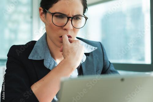 Slika na platnu Beautiful Business Woman Bitting Her fingernails at work office