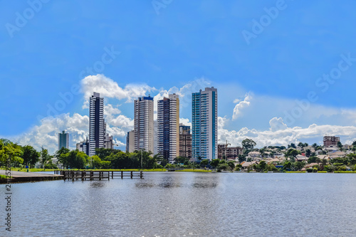 Fotografija  Partial view of the lake in the Parque das Nações Indígenas and buildings in the background, in the city of Campo Grande, capital of Mato Grosso do Sul, Brazil