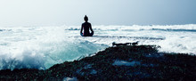 Woman Practice Yoga At The Sea...