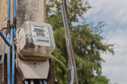 Power meter on the pole - Buy this stock photo and explore