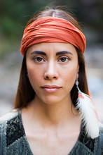 Wise, Indigenous, Beautiful Woman With A Bandana And A Feather
